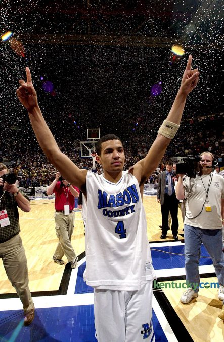 Under a sea of confetti, Mason County guard Chris Lofton shows the Rupp Arena crowd who is number one after the Royals beat Ballard in the finals of the Boys' Sweet Sixteen basketball tournament March 22, 2003 in Lexington. Lofton led Mason County to it's first state basketball title with his tournament Most Valuable Player performance that included a record-tying nine three-pointers in the 86-65 championship game victory. The next year Lofton added Mr. Basketball honors to his resume. He then played college ball at Tennessee where he broke the SEC record for career three-pointers - 431. Currently, he has built a professional career playing basketball overseas. Photo by Marck Cornelison | staff