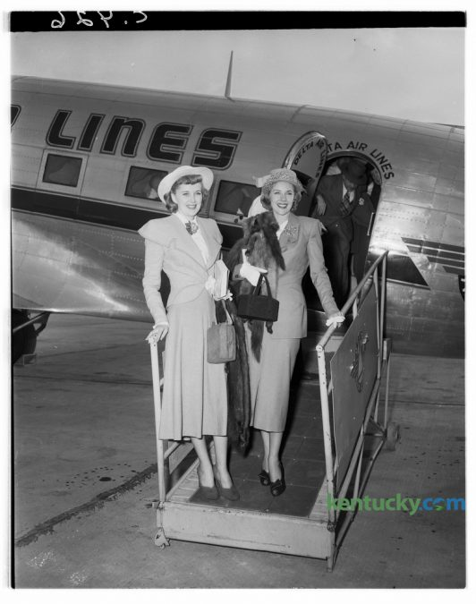 "Marie ""The Body"" McDonald, right,  posed with Mrs. Danny Bordett, upon her arrival in Lexington's Blue Grass Field in April 1948. She was enroute to visit relatives in Burgin, Ky., her home town.  McDonald was born Cora Marie Frye,  and after her parents divorce she moved with her mother and stepfather to Yonkers, New York. At the age of 15, she began competing in numerous beauty pageants and was named ""The Queen of Coney Island"", ""Miss Yonkers"" and ""Miss Loew's Paradise"". At the age of 15, she dropped out of school and began modeling. In 1939, McDonald was named ""Miss New York State"". She landed a showgirl role on Broadway at age 17 and shortly thereafter moved to Hollywood. She appeared in films and on stage until her death in 1965. Published in the Lexington Leader April 27, 1948. Herald-Leader Archive Photo"