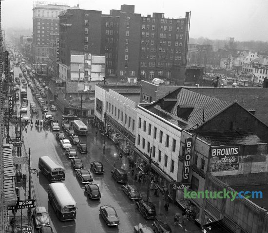 Hundreds of out-of-town automobiles added to the difficulty of a typical downtown Lexington traffic jam March 17, 1951. Thousands of loyal fans of teams in the 34th annual state high school basketball tournament flocked to the city for the semi-finals and finals being held at Memorial Coliseum. Clark County won the tournament defeating Cuba 69-44. The photo was taken from the First National Bank Building, with a view toward the east including the busy Main and Limestone intersection. Herald-Leader Archive Photo