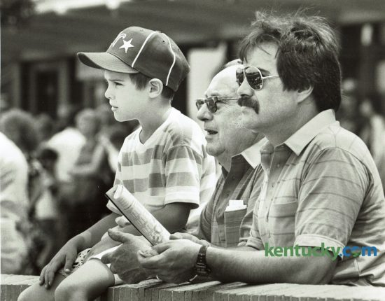 Chad Morgan Batten, 7, his grandfather Frank Batten, Jr. and his father Frank Batten III enjoyed a Father's Day outing at the Red Mile on Sunday June 19, 1988. The Standardbred race track had some special festivities for fathers, including the naming of a Father of the Year. Bobby White of Corbin, a father of six, got the award based on a letter written by his daughter Darlene. Photo by Craig Sands | Staff