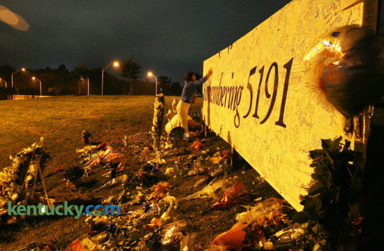Members of Delta's Care Team stopped by a memorial for Comair Flight 5191 crash victims on their way to catch an early morning flight at Blue Grass Airport in Lexington on Sunday, Sept. 3, 2006, exactly one week after the accident. Saturday, August 27, 2016 marks the 10 year anniversary of the crash that killed 49 of the 50 people on board. Matthew Snoddy's father, Tim, was a passenger on the flight. He shares his family's story from that terrible day. Photo by David Stephenson   Staff
