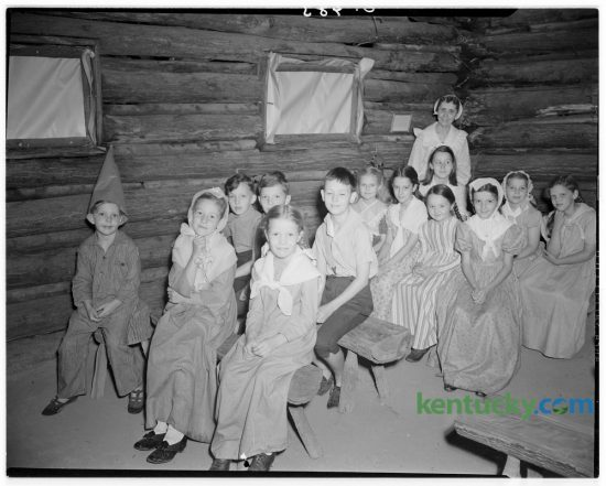 Local children portrayed a scene in a pioneer log school during a celebration of the 168th anniversary of the founding of Fort Harrod on June 16, 1942, the first Anglo-Saxon settlement west of the Alleghenies. This weekend the Pioneer Days Festival is being held at the Old Fort Harrod State Park in Harrodsburg. Photo by J.W. Spencer | Staff