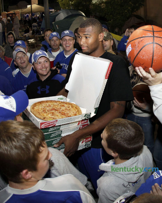 Kentucky basketball player DeMarcus Cousins called out with pizza as UK players served pizza and signed autographs and coach John Calipari signed for fans who were camping out for Midnight Madness on Friday October 2, 2009 in Lexington. The team frequently brings campers pizza during their stay on the grounds outside Memorial Coliseum. This years campout for Big Blue Madness tickets starts at 5 a.m. Wednesday and ends when tickets are distributed at 10 p.m. Friday. Photo by Mark Cornelison   Staff