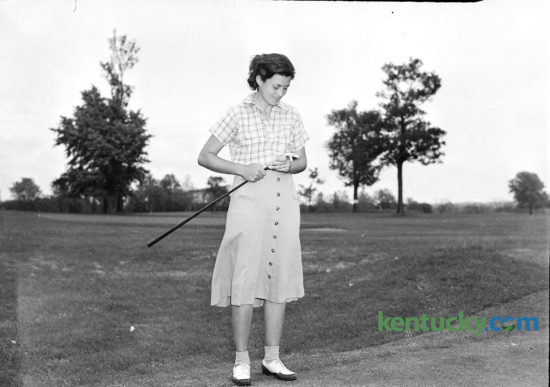 """Pioneer golfer Marion Miley, 1941. In an era before women's professional golf, the Lexington resident won almost every important women's amateur championship except the national title, which eluded her in some close tournaments. Miley and her mother were brutally murdered during a robbery at Lexington Country club 75 years ago this week — a crime that sent three men to the electric chair. Miley's life and tragic death are explored in a new Kentucky Educational Television documentary film, """"Forgotten Fame: The Marion Miley Story"""". KET will begin airing the documentary today. Herald-Leader Archive Photo"""