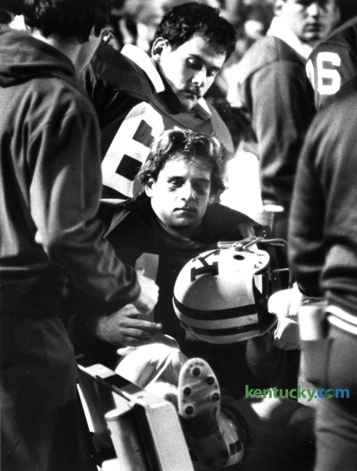 UK quarterback Doug Martin sat on the UK bench after injuring his knee in a 34-10 loss to LSU, Oct. 16, 1982.