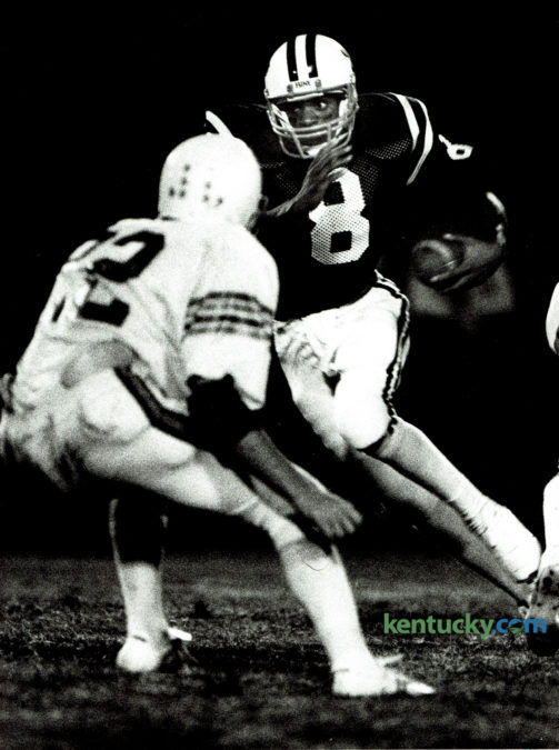Tates Creek quarterback Ron Mack looked for running room against the Cawood Trojans on September 16, 1983. The Commodores pulled out the victory driving 77 yards in 14 plays as Mack ran the ball in from the 7 yard line with 48 seconds remaining. The Commodores take on Madison Southern tonight at home. Photo by Ron Garrison | Staff