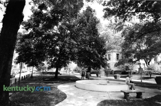 Cheapside Park on Main Street in Lexington, Aug. 24, 1989. The Fayette County Courthouse is visible through the trees, just over the fountain. The name Cheapside was taken from the historic marketplace in London, England. As a maketplace during the slavery era, Cheapside became the largest slave market in the South. After the war it was a public square and market, hosting Court Days for public trading until 1921. The popular downtown free concert series, Thursday Night Live, started here in 1994 and in 2010 a permanent facility for the Farmers Market opened on the site with the unveiling of the Fifth Third Bank Pavilion. The glass pavilion covers about 5,700 square feet that can accommodate approximately 28 stands on market day. On the far left of the picture, you can see the Cheapside, a one-way, one-block street between West Short and West Main streets. In late 2008, the Urban County Council approved the permanent closure of Cheapside to vehicular traffic. Photo by Clay Owen | staff
