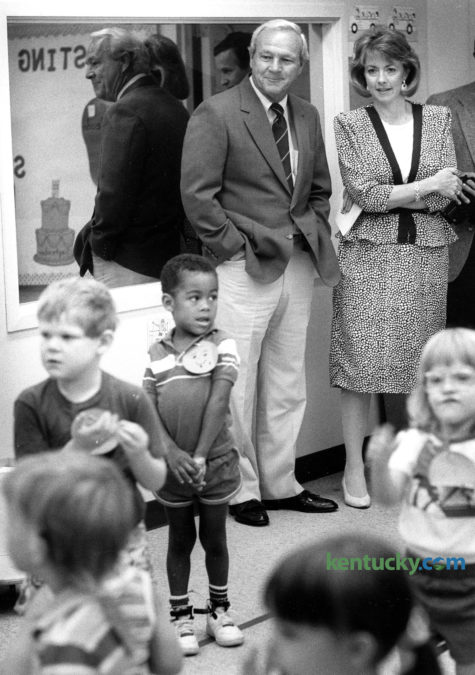 """Golf legend Arnold Palmer got a tour of the Child Development Center of the Bluegrass in Lexington from Executive Director Peggy Stephens Sept. 11, 1989. Palmer visited two United Way of the Bluegrass agencies, the Center for Creative Living, a day care program for senior citizens, and the Child Development Center, which provides early intervention and therapy services for children with and without disabilities. Palmer, a spokesman for GTE throughout the United States, was invited to tour the agencies by Bob Calafell, chairman of this year's United Way general campaign and vice president and general area manager of GTE South. At the Child Development Center, Palmer signed autographs, watched children eat and play, and encouraged a boy undergoing physical therapy. """"I feel grateful that I'm in a position to help raise money,"""" Palmer said. """"I do (these things) because I feel like if I can help give other people the same opportunities I've had, that's good enough for me. When I . . . see what is happening in a place like this or in children's hospitals, I think of how fortunate we are that we do have people that really do care. That is something you just can't replace."""" Palmer, who made golf popular for masses, died Sept. 25, 2016. Photo by Clay Owen"""