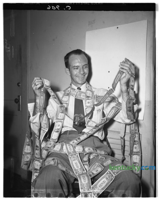 William Nash Payne was photographed wrapped up in 101 feet of dollar bills  as he was slowing moving toward his goal of 5,280 feet as his part of the Epworth Methodist church's building fund in August 1948. So far Nash had collected $203 or 101 feet of bills. A mile will amount to $10,000. Published in the Lexington Herald August 19, 1948. Herald-Leader Archive Photo