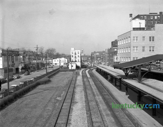 The view looking west down Lexington's Union Station Railroad yards in the winter of 1956. The photo was taken from on top of the Walnut Street (now Martin Luther King Blvd) viaduct. Union Station opened in 1907, and the last train left the station in 1957. The building was torn down in 1960. The tracks were removed in 1968 and Vine Street, which can be seen on the left side of the photo, were widened in their place.