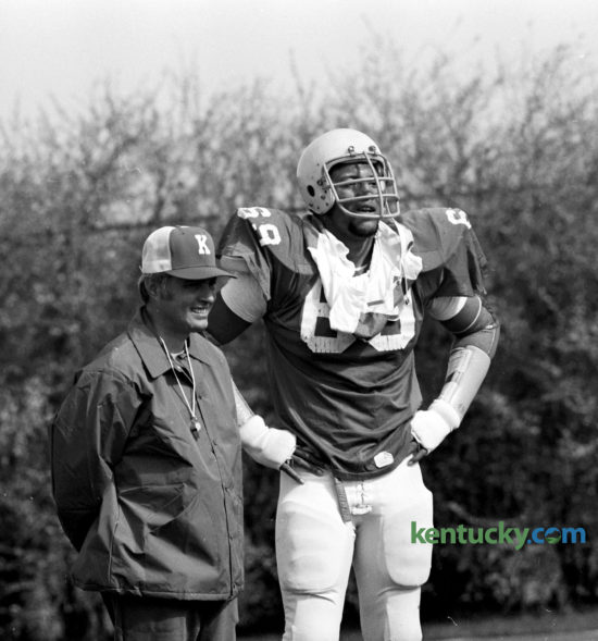 University of Kentucky football coach Fran Curci looked on with his star, Warren Bryant as the Wildcats formally opened their spring practice, March 6, 1976. The offensive tackle became a cornerstone of Kentucky's 1976 SEC co-championship team. But the Cats were not crowned co-champions until 1978 because Mississippi State was forced to forfeit all its games from 1976 because of an ineligible player. It is the most recent SEC football championship for UK. Bryant went on to be the sixth overall pick in the 1977 NFL Draft by Atlanta. The 6-foot-6, 273-pound Florida native went on to play 164 games, starting 93, in the NFL. During Bryant's time in Atlanta (he also played five games with the Raiders), the Falcons made the playoffs for the first time in franchise history (1978). Photo by E. Martin Jessee | Staff