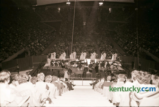 The first concert in Rupp Arena featured Lawrence Welk and his orchestra and was attended by Adolph Rupp, the legendary basketball coach and his family. Welk, then 73, had been friends with Rupp for many years and told the crowd that Rupp had promised him a chance to play at the opening of his new home. He thanked the former coach and gave him a baton as a memento. About 20,000 fans attended the afternoon show on Sunday October 17, 1976.
