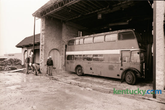 Workmen oversaw the move of an English double-decker bus into the interior of a new restaurant at the corner of Nicholasville Road and Reynolds Road on October 25, 1976. A new restaurant called Darryl's 1891 was being build in what had been the Don Q Restaurant. The new eatery was set to open in early spring of 1977 and promised a full-service menu featuring good food at reasonable prices. The bus was meant to serve as a focal point of the restaurant, creating a unique atmosphere. The Lexington location, now home to the Walgreens at Reynolds Road, closed in January 2002. Photo by Ron Garrison | Staff