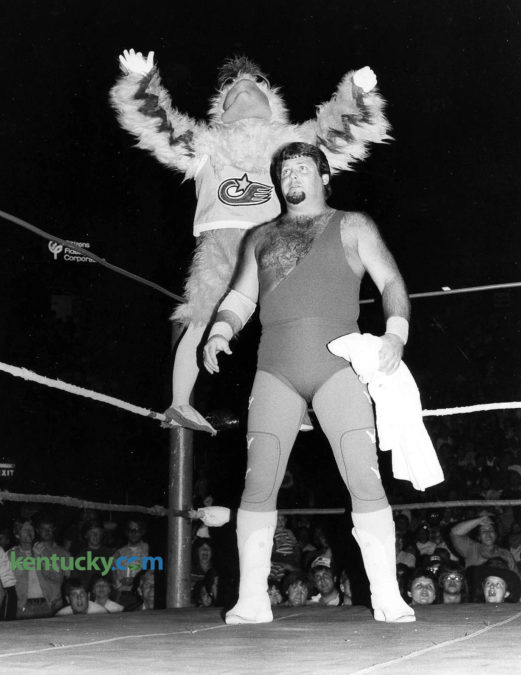"""The San Diego Chicken with wrestler Jerry """"The King"""" Lawler before the A.W.A Southern Heavyweight Championship match Oct. 6, 1983 at Rupp Arena. Tickets were $7 for ringside seats, $6 for general admission to see the famous mascot as Lawler's manager. The wrestling legend was facing another legend, Jessee """"The Body"""" Ventura, who was managed by Jimmy Hart. Lawler won, and as part of a bet, Hart had to wear a chicken suit. After putting on the suit, The Chicken hit him with a flying drop kick that made his feathers fly. Eight days later, The Chicken - one of the most influential mascot in sports history - appeared at a University of Kentucky volleyball game. At 9 p.m. on Oct. 14, a record 7,830 fans paid $1 to see No. 5 UK lose to No. 1 Hawaii in Memorial Coliseum. Three hours later, Wildcats coach Joe B. Hall held the second ever Midnight Madness, the annual first basketball practice of the season. Photo by Tom Woods."""
