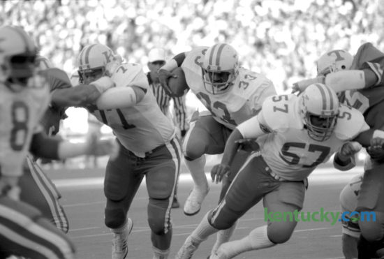Kentucky running back George Adams (33) broke through the line in UKÕs last win over Tennessee, Nov. 24, 1984 in Knoxville.  The Wildcats prevailed 17-12. Adams, the tailback from Lexington rushed for 110 yards and two touchdowns. Kentucky finished their season under coach Jerry Claiborne 9 and 3 and beat Wisconson in the Hall of Fame Bowl in Birmingham 20-19. Photo by Tom Woods | Staff