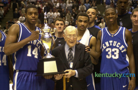 Legendary and former coach of UCLA John R. Wooden held the game trophy with the UK team after the Wildcats  beat the Bruins 52-50 in the John R. Wooden Classic on Dec. 6, 2003, in Anaheim, Calif. UK players in front include, from left, Erik Daniels, Gerald Fitch and Antwain Barbour. The 2016 version of the matchup is Saturday, as Kentucky hosts UCLA in Rupp Arena at 12:30 p.m. Photo by David Stephenson | Staff