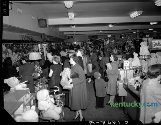 """A crowd of Christmas shoppers filled the S. S. Kresge Store in downtown Lexington on December 9, 1948. S.S. Kresge, a Detroit, Michigan company, brought their 5 and 10 cent stores to Lexington in 1912. The downtown store was at  250  West Main Street, across from Cheapside Park. The store closed in 1967 and is now the site of the Lexington Financial Center, more commonly known as the """"Big Blue Building."""" The S.S. Kresge Co. was renamed Kmart Corp. in 1977."""