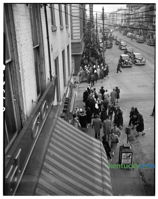 "Christmas shoppers along West Main Street with the largest crowd on the sidewalk outside the Purcell Company department store, top left, in December 1945. The Lexington Leader reported ""that despite of continuing scarcity of many articles, including toys, Lexington stores have been jammed with shoppers the last several weeks.""The photo was taken from a second story window of B.B. Smith and Company clothing store, just east of Mill Street, looking west along Main Street. Published in the Lexington Leader December 18, 1945. Herald-Leader Archive Photo"