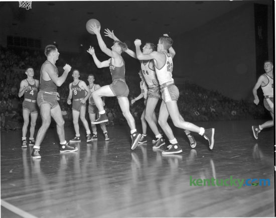Lafayette High school guard Jimmy Hutchens put up a shot during the Generals Dec. 2, 1950 game against Clark County. The game was a rematch of the previous season's finals of the state basketball tournament, won by Lafayette. This time around Clark County got revenge in front of the 5,000 fans at UK's Memorial Coliseum, winning 55-51. The Cardinals would finish the season winning the school's first state title. In 1963 they were consolidated with Winchester High School and are now known as George Rogers Clark High School. Published Dec. 3, 1950 in the Sunday Herald-Leader