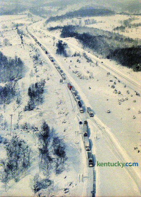 One of the worst snowstorms in 16 years stunned Kentucky Jan. 18, 1994, closing virtually every main road and airport, causing hundreds of accidents and bringing sub-zero temperatures. Snow depths ranged from 3 inches in southwestern Kentucky to 25 inches in Robertson County, the hardest hit spot in the state. Lexington had 10.2 inches. Louisville had 15.9 inches. Gov. Brereton Jones declared a state of emergency and closed all of the interstates — I-75, I-71, I-64, I-65 and I-24 — and the Blue Grass Parkway. Police, however, were too understaffed to enforce the closures. Most county and state roads were blocked because of accidents or closed by local officials, state police said. Jackknifed tractor-trailers littered the highways. Hundreds of motorists were stranded. There was little room for rescue workers to get through to help them. Shown here, southbound traffic on I-75 was frozen in its tracks near the Corinth exit south of Dry Ridge after the interstate was shut down. Grant County Department of Emergency Services coordinator Rick Willoby said crews can't clear the roads until those trucks are moved, and it's been difficult to find enough equipment to tow tractor-trailers out of the way. In Lexington the high was 4 degrees and the low was -9, breaking a a 64-year-old record by three degrees for the date. City workers spent most of yesterday clearing roads and towing more than 100 cars from the main arteries. Photo by Charles Bertram | staff