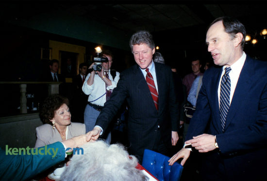 "Arkansas Gov. Bill Clinton and Kentucky Gov. Brereton Jones greet diners at Flynn's Restaurant and Statesman Lounge in Frankfort, Feb. 4, 1992. Clinton took time out from campaigning in New Hampshire to gather the endorsements of Jones and a host of other top Kentucky Democratic officials. In an impassioned speech to about 300 people crammed into the Capitol Rotunda, Clinton acted as if he already was running against Bush rather than his opponents in the Democratic primary. He never mentioned any of his Democratic opponents by name; U.S. Sens. Tom Harkin of Iowa and Bob Kerrey of Nebraska, former U.S. Sen. Paul Tsongas of Massachusetts and former California Gov. Jerry Brown. Clinton said Bush and the Republicans have been sending the wrong message to the nation: ""Turn a quick buck, get it while you can and walk away with the money."" This attitude has helped produce severe economic problems that Bush does not understand, Clinton said. Later, at a news conference outside Flynn's restaurant, reporters did not ask Clinton the kinds of questions about marital fidelity that made national news the week prior. Instead, most of the questions dealt mainly with details of his economic and educational proposals. Jones' endorsement was important because it could influence the state's 61 delegates to the Democratic presidential nominating convention. Clinton returned to New Hampshire that night, which held the first Democratic primary two weeks later, which he won, catapulting his successful bid to the White House that November. Jennifer Podis 
