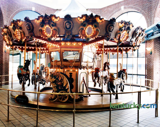 "The carousel in Festival Market, now called Triangle Square, July 25, 1994, three days after it and the building was sold at auction. The 22-foot-wide, 12-horse carousel was bought by politician and Lexington caterer Jerry Lundergan for $35,000. He tried to sell it to the Lexington Children's Museum for the same price he paid for it. Mayor Pam Miller said the city had considered buying the carousel for the museum but they didn't have the money to buy it or someone to run it and ""there is no extra space in the Children's Museum,"" she said. Lundergan eventually sold the carousel to Tom's Farms, a produce and amusement complex in Corona, Calif. It is still in use there today. ""It's a beautiful piece of equipment,"" Lundergan said after the auction for the carousel, which was built in San Francisco in 1986. ""It was the showpiece of Festival Market."" The carousel was always popular and added to the vibrancy of the mall, said Dudley Webb, partner with the Webb Cos. which developed the downtown Lexington shopping center. The $16 million, three-story mall opened in 1986 as Lexington Festival Market, designed as an upscale center with dozens of shops and restaurants. While children rode the merry-go-round on the top floor, a jazz pianist played lunchtimes in the courtyard below. However, the mall, which was expected to have up to 70 businesses, never found its niche and has lost money each year since it opened. At the time of the auction, the it was in the midst of converting from an upscale center to a factory outlet mall. Developed by the Webb Companies in partnership with Kentucky Central Life Insurance Co., the mall became a casualty of the failure of Kentucky Central. When the insurance company failed in 1993, the mall was placed in receivership. The estimated debt of the mall was more than $13 million, according to court records. The Webbs had managed the mall since it opened but gave up, citing frustration over efforts to revitalize it. A judge's order dissolved the pa"
